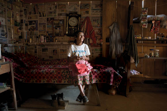 Marta Tomasa Cedilla de Avila, sitting on the bed in her new house in the village of Batzchocola.  This is the first time in her life that she has lived with anything better  than a dirt floor. Tomasa has seen 11 of her 15 children die, some of them  by machetes and bullets during the Guatemalan civil war.