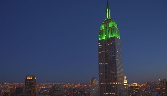 empire-state-building-green-light-night-city-new-york-lights-dark-blue-sky-photo