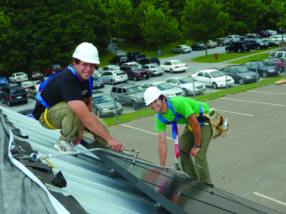 Up on the Roof. Ben Brown, Team Safety Officer, and Danny Powers, Construction Foreman, install Solar Panels at our Middlebury Construction Site. Photo by Middlebury College Solar Decathlon Team